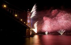 Thousands gathered to watch as fireworks, augmented by beams of light from a barge and the Golden Gate Bridge, lit up the night sky and San Francisco Bay.    Photo: Michael Macor / The Chronicle