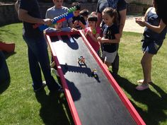 Lego race track. Kids built there own car and then raced them. It was a hit at the party. Even the dads got into it!