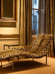 The leopard chaise and traditional architectural details