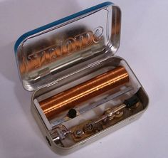 I love this design. Its a Crystal Radio in an Altoids tin. A crystal radio is a radio that can pickup stations and does require a power source.