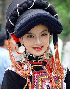 China |  Yi woman.  The Yi costumes vary greatly depending on where they live; in china they live primarily in rural areas of Sichuan, Yunnan, Guizhou and Guangxi, usually in mountainous regions.