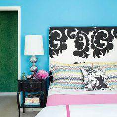 We love how this bold black-and-white headboard stands out against the bright blue wall.