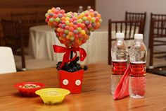Create a Mickey Mouse party topiary! See this party on Kara's Party Ideas. www.KarasPartyIdeas.com #mickey #mouse #party #ideas #candy #topiary