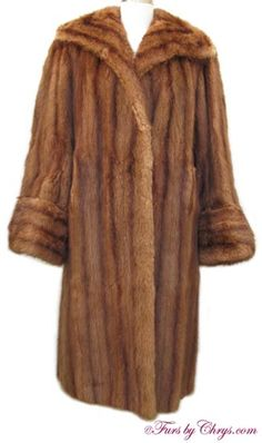 SOLD! Vintage Whiskey Muskrat Fur Coat #M710; Good Condition;  Misses 10 - 14. This is a beautiful genuine muskrat fur coat dyed to resemble whiskey mink. It features a large wing-style style collar, deep non-adjustable turn-back cuffs and has that stunning 40's vintage style. Muskrat resembles mink, is a very good and very warm fur, and is very under-rated. If you love the look of yester-year and want to be snug in those cold days of winter, look no further than this vintage muskrat coat! warm fur, fur coat, vintag fur, fur fashion