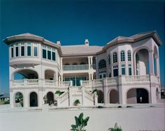 Rear exterior of a Riverfront estate built by Daniel Wayne Homes, luxury home builder in Fort Myers, Florida.