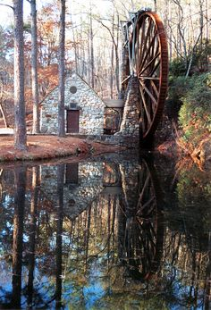 Old Berry Mill on the campus of Berry College just north of Rome Georgia.  It was constructed in 1930 by students of the college.  The wooden waterwheel is considered one of the largest in the world at 42 feet in diameter.  The mill operates on special occasions such as Mountain Day and sells the ground cornmeal.