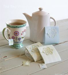 Make your own tea bag wrappers out of pretty scrapbook paper. I love the delicate floral punches that close up the bags.