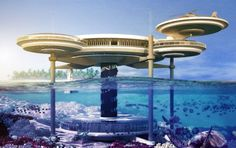 """The Water Discus Hotel; part spaceship, part underwater odyssey. """"The phenomenal structure consists of two discs; one built above the water level while the other one located 10 meters below the surface. Three perpendicular pillars run through the two discs and are linked by a fourth assembly that accommodates the elevator and staircase"""". The hotel also has a diving school and bedrooms have a scenic view of the ocean; either from above or below."""