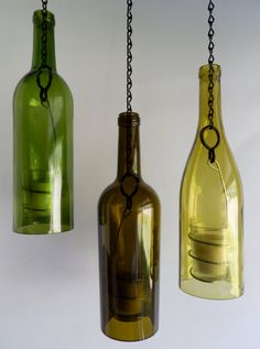 Three Glass Wine Bottle Hanging Lanterns - bottoms cut out to be used for candles.