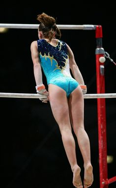 Gymnast on uneven bars, women's artistic gymnastics sports photography athlete athletics sports #KyFun gimnasia artística, artist gymnast, gymnast sport, ph 777, sport photography, power gymnast