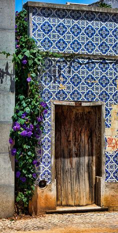 Love the blue tile wall and old wood door.
