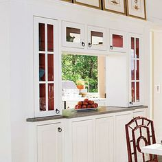 Neutral Treasures | Highlight a neutral collection by painting the interior of glass-doored cabinets in a contrasting color. | SouthernLiving.com