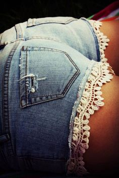 cut old jeans and sew a lace trim on