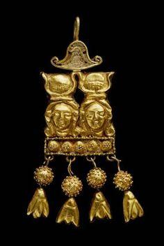 An ancient Nubian golden earring with two portrayals of the ancient Egyptian mother goddess Hathor, wearing her sun-and-cow's-horn headdress. (Museum of Fine Arts, Boston)