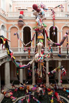 The Portuguese artist Joana Vasconcelos was born in Paris in 1971; she currently lives and works in Lisbon. Her work Contamination consists of a patchwork sprawl of brightly colored forms that invade the architecture of Palazzo Grassi. Constructed out of materials either handmade by Vasconcelos herself or found during her visits to several countries over the past three years, Contamination is in constant growth as Vasconcelos continues to add new elements to her work during each of its instal...