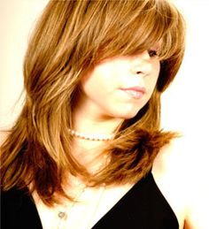 Long Shaggy layers w/Bangs...haircut....Golden Blonde Highlights On Golden Brown Base- Hair Color....Thick Hair w/ wave