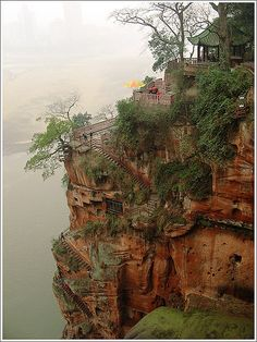 Grand Buddha Hillside, China--  plank road built along a cliff in the Grand Buddha scenic spot