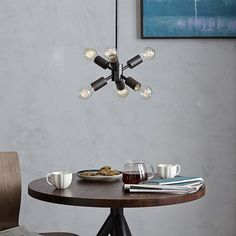 With its compact shape, our Mobile Small Pendant adds intrigue to an entryway or over a bistro table. Made of iron in a plated antique bronze finish, it dazzles when paired with frosted, oversized bulbs.