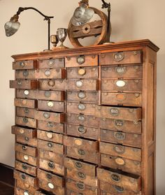 I would LOVE something like this for my craft storage. So antique shabby and practical all at the same time!