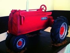 Farmall Tractor for a groom's cake.  This was quite the challenge!!  LOL  Tractor body made from cake, tires made from rice crispy treats and chocolate, and all other parts made from fondant.  TFL! tractor cake, farmal tractor, tractors, cake idea, cakes, farmall cake, the challenge, tractor grooms cake, groom cake