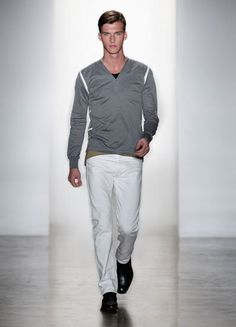 Simon Spurr ss12 - grey y-neck pique henley with white mac-taped seams, black crewneck sleeveless t-shirt, tan quilted belt, white selvage jeans