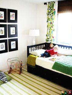 Love the simple boys room with the black square frames on the wall!