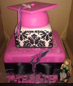 Pink graduation cake with damask pattern. Pink graduation cake cap. Color guard themed graduation cake.