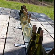 Amazing DIY picnic table that keeps your beer or wine cold!   http://www.foodrevu.com/just-for-fun/picnic-table-that-keeps-your-beer-or-wine-cold/