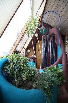 """Earthship"" shower & a garden"