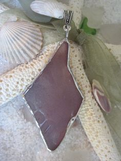 Rare Purple Sea Glass Pendant #sea glass beads & #sea charms: http://www.ecrafty.com/c-780-sea-glass-beads.aspx?pagenum=1===newarrivals=60