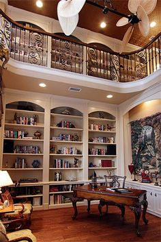 Home library... This library for the current living room. Add a second story on the flat roof to finish the library and sitting area. preferably a round roof to add to the nautical feel of the home.