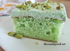 Pistachio Cake. I'm not one to use boxed cake mix but this looks too good!