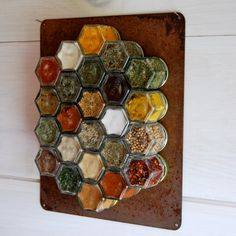 RUSTIC Custom Magnetic Spice Rack.  Set of 24 EMPTY hand-stamped jars with rusted metal wall plate. Complete  Your Rustic Kitchen Decor.. $130.00, via Etsy. ---Without the rusty plate!