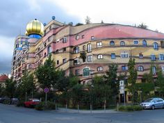 Forest Spiral – Hundertwasser Building (Darmstadt, Germany) The structure with 105 apartments wraps around a landscaped courtyard with a running stream. Up in the turret at the southeast corner, there is a restaurant, including a cocktail bar.