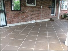 Stain your cement to look like tile! Looks awesome & cheap!