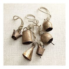 rustic bell ornaments from Crate and Barrel - I want to find some like this REALLY BAD!
