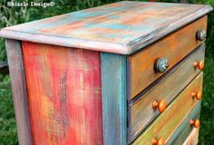 Whimsically hand painted dresser by Shizzle Design of West Michigan layered in American Paint Company's chalk/clay/mineral paints and finished off with Light Antiquing Wax. For location and availability of this piece, visit: http://shizzle-design.com/2013/07/whimsical-patchwork-painted-dresser-with-apcs-antiquing-wax.html