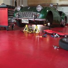 Learn how to apply epoxy floor paint to your garage at http://staging.familyhandyman.com/DIY-Projects/Flooring/Garage-Floor/how-to-apply-epoxy-floor-paint-to-your-garage/View-All