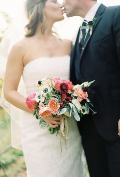 #WeddingBouquet of coral charm peonies, scabiosas, anemones, veronica, jam tart roses, dusty millers, and peppercorns | Brides.com