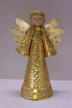 Traditional Style Gold Angel for a Christmas tree topper or decoration.