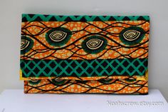 Clutch:Ankara African wax print clutch purse. $38.00, via Etsy.