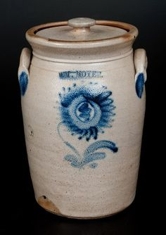 """Sold $950 Rare One-Gallon Stoneware Jar with Cobalt Sunflower Decoration, Stamped """"WM. MOYER,"""" Harrisburg, PA, circa 1858, cylindrical jar with flared rim and applied lug handles, decorated with a finely-brushed design of a sunflower plant with large, nicely-detailed center and sawtoothed leaves. Brushed cobalt highlights to maker's mark and handle terminals. Includes 20th century Diebboll lid. Excellent decoration, size, and color. Excellent condition with a few"""