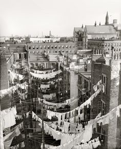 """Online: Circa 1900-1910. """"Yard of tenement, New York City."""" Hung out to dry somewhere in Manhattan. Detroit Publishing Company glass negative. Click to view full size."""