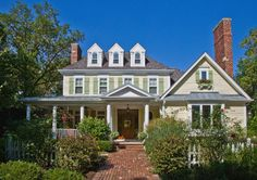 Colonial home with wrap-around porch and brick front walk - Oakbrook, Illinois