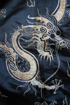 completely hand sewn and the embroidery isn't thread, it's actual metal wire! With all of the intricate flower and dragon designs, all of th...