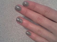 "Simple nail design with ""wet cement"" grey and white dots"