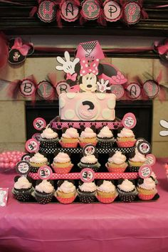 Decorated cupcakes at a Minnie Mouse Birthday Party!  See more party planning ideas at CatchMyParty.com!