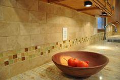 Tile backsplash photo: Durango travertine tile backsplash with glass mosaic tiles used as accent pieces.