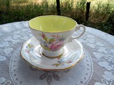 Vintage Teacup Tea Cup and Saucer floral English Floral with Yellow Inside.   via Etsy.