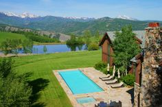 A picturesque home with the most perfect blue pool you'll ever see. Aspen, CO Coldwell Banker Mason Morse Real Estate